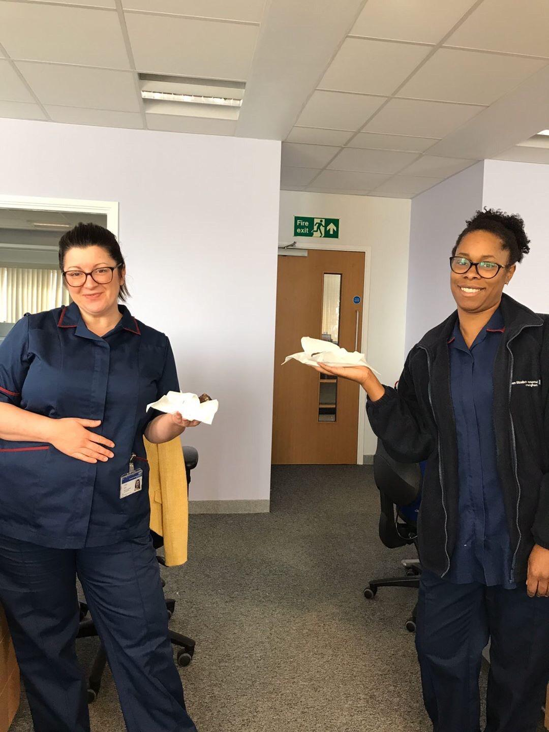 A photo of NHS staff members holding treats from Mary's