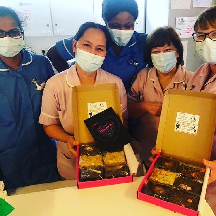 A photo of NHS staff holding treat boxes from Mary's
